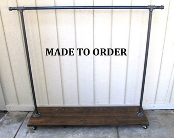 clothing rack, garment rack, clothes storage, pipe clothing rack, store fixture, industrial