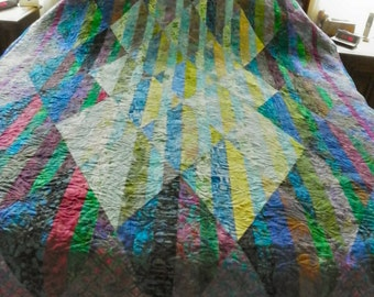 Twin quilt of Batik strips in blues and greens
