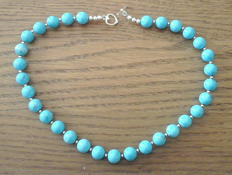 RARE superb turquoise beads and sterling silver beads.