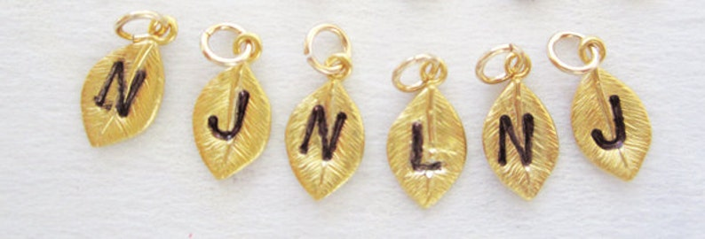Make a personalized gift Add an initial charm Personalized Initial Charm Gold leaf initial charm Hand Stamped Initial Leaf muse411