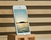 Acoustic iPhone 5 dock in Curly Maple - Amplifies sound through unique acoustical pockets .