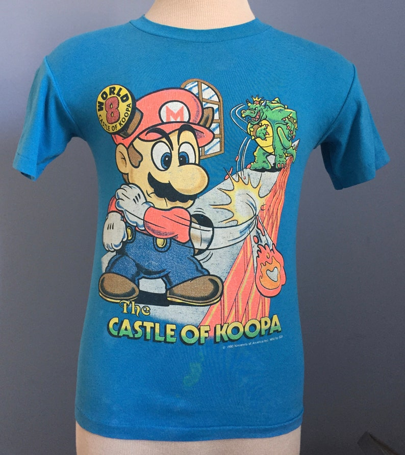 90s Vintage Super Mario Bros 3 The Castle of Koopa 1990 World 8 Nintendo  king promo video game T-Shirt - XS X-SMALL
