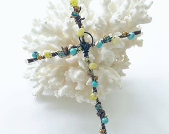 Center  White Pearl Nest cross