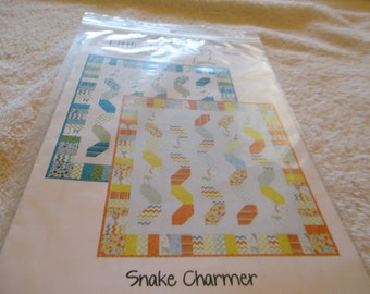 Snake Charmer paper quilt pattern designed by Little Lousie for a crib quilt in two color ways