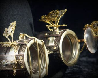 Steampunk goggles in brown leather and brass with mechanical butterflies, folding lens  and embossed decoration