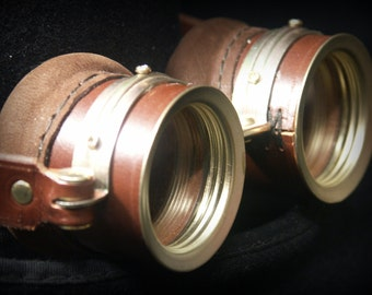 Steampunk goggles in brown leather and brass.
