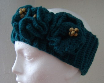 Crochet green headband with flower detail and beads on the side
