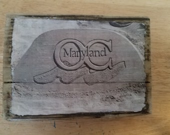 Ocean City, Maryland logo in sand