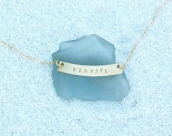 Gold Namaste Curved Bar Necklace