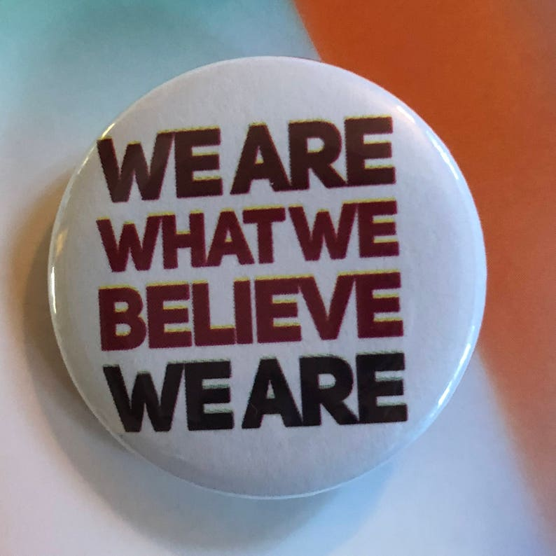 We Are What We Believe We Are white design Pinback Buttons image 0