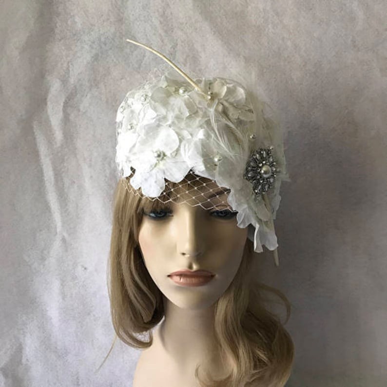 e53d0b5e4dd White vintage style church hat with long feather quill and