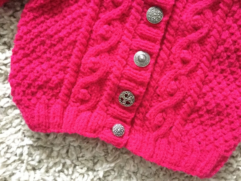 Bright cerise cabled aran cardigan with vintage metal buttons