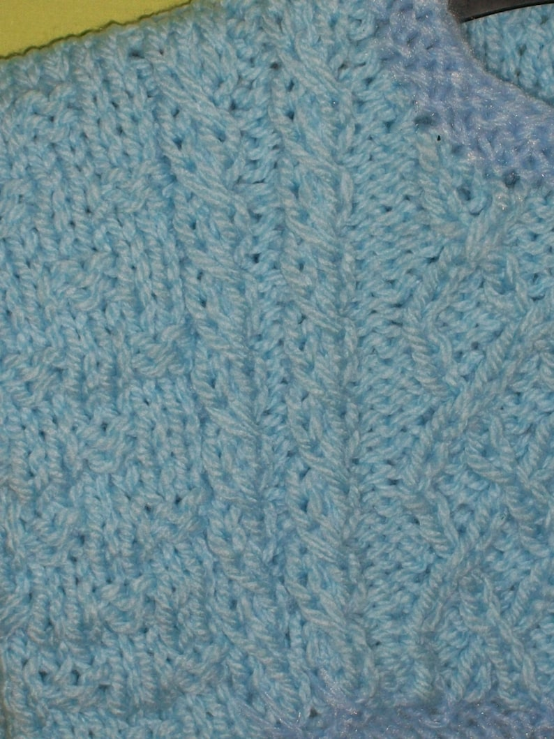 Sale item  Blue chunky jumper with cabled patterns for 6 to 9 month old