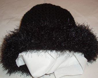 Black Hat, with lapels in fake fur sparkling
