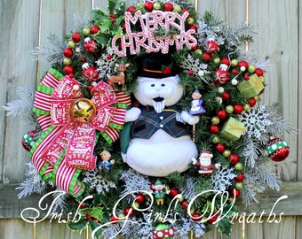 sam the snowman rudolph christmas town wreath peppermint santa and mrs claus hermie the dentist elf christmas decor candy cane