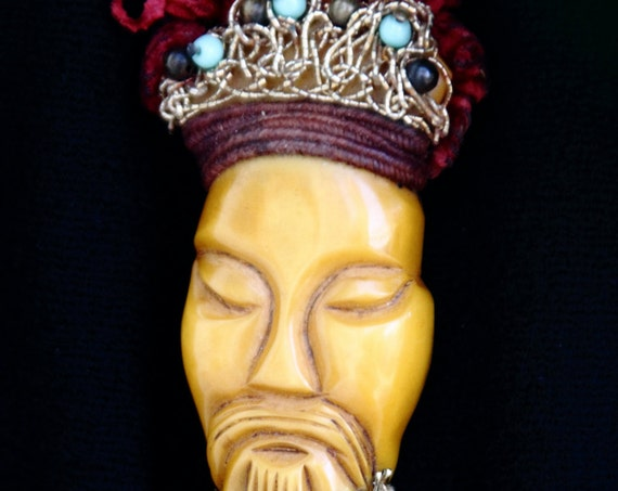 Carved, 1930s, resin washed butterscotch bakelite brooch of asian figure or man's face, with ornamentation Large 3 3/4 x 1  1/2