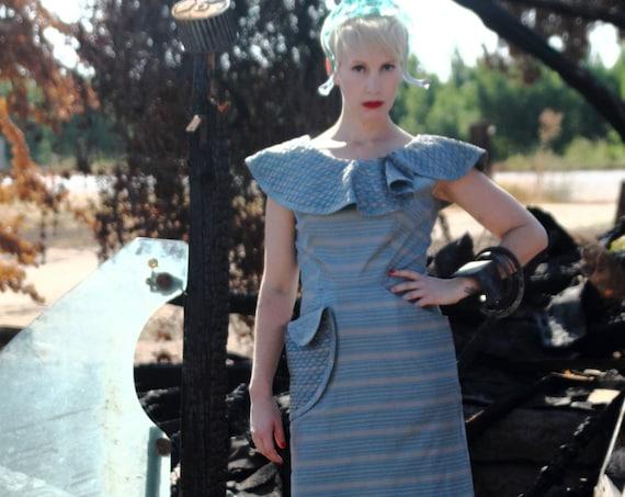 Futuristic late 1950s early 1960s dress avant gard collar and pocket design.  Mid Century Futurist style.