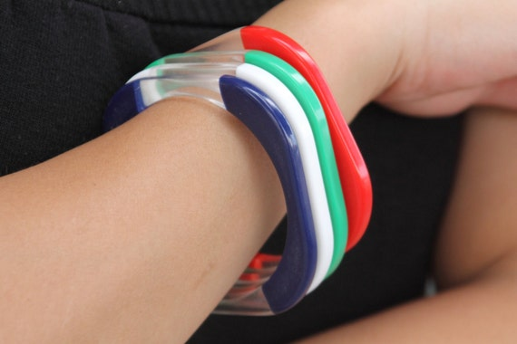 Set of 4 1940s square lucite bangles, red, green, white, blue and clear