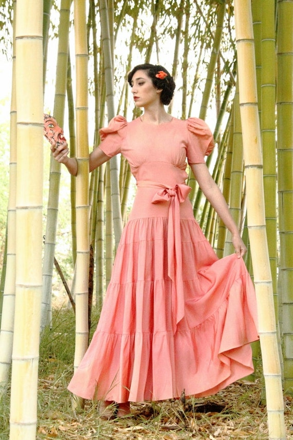Striking coral pink 1930s gown, Low back, dramatic puff sleeves, sash belt