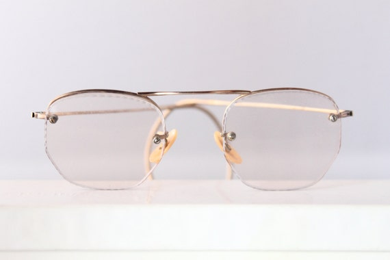 """1930s rimless gold filled eyeglasses with Deco patterning by """"W"""" or Wellington Optical, The Continental"""