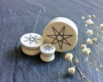 "Faerie Star Plugs. Septagram. 2g / 6.5mm, 0g / 8mm, 00g / 10mm, 1/2"" / 12.5mm, 9/16"" / 14mm, 5/8"" / 16mm, 3/4"" / 19mm, 7/8"" / 22mm, 1"" /25mm"