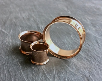 "Rose Gold Steel Tunnels. 2g -6.5mm, 0g -8mm, 00g -10mm, 7/16"" -11mm, 1/2"" -12.5mm, 9/16"" -14mm, 5/8"" -16mm, 3/4"" -19mm, 7/8"" -22mm, 1"" -25mm"