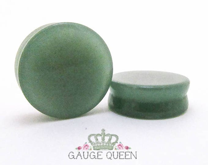 "Natural Jade Stone Plugs / Gauges. 2g /6.5mm, 0g /8mm, 00g /10mm, 1/2"" /12.5mm, 9/16"" /14mm, 5/8"" /16mm, 3/4"" /19mm, 7/8"" /22mm, 1"" /25mm"