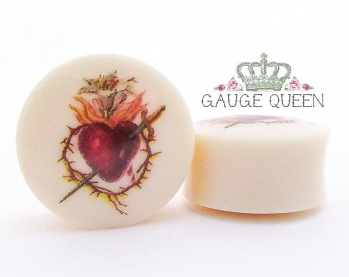 "Sacred Heart Plugs / Gauges. 2g / 6.5mm, 0g / 8mm, 00g / 10mm, 1/2"" / 12.5mm, 9/16"" / 14mm, 5/8"" / 16mm, 3/4"" / 19mm, 7/8"" / 22mm, 1"" / 25mm"