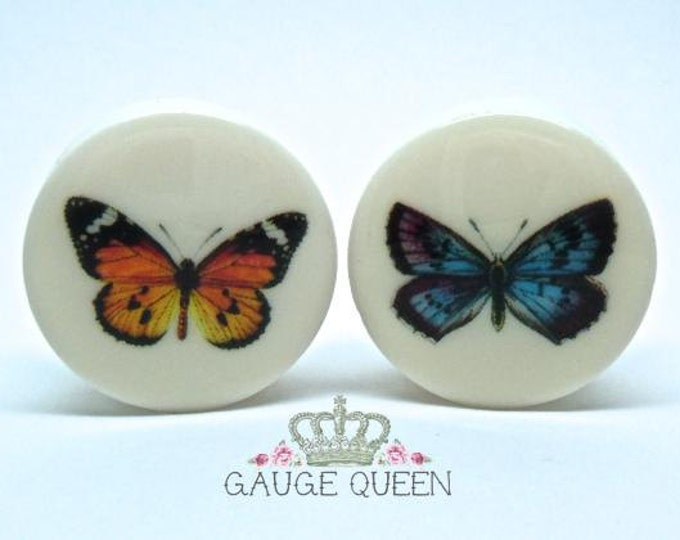 "Butterfly Plugs / Gauges. 2g / 6.5mm, 0g / 8mm, 00g / 10mm, 1/2"" / 12.5mm, 9/16"" / 14mm, 5/8"" / 16mm, 3/4"" / 19mm, 7/8"" / 22mm, 1"" / 25mm"