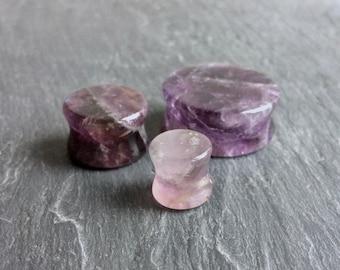 "Lilac Amethyst Stone Plugs. 2g - 6.5mm, 0g - 8mm, 00g - 10mm, 1/2"" - 12.5mm, 9/16"" - 14mm, 5/8"" - 16mm, 3/4"" - 19mm, 7/8"" - 22mm, 1"" - 25mm"