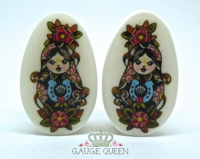 "Russian Doll Plugs / Gauges. 2g / 6.5mm, 0g / 8mm, 1/2"" / 12.5mm, 9/16"" / 14mm, 3/4"" / 19mm, 7/8"" / 22mm, 1"" / 25mm"