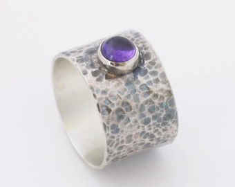 Purple silver ring - wide hammered silver band with cabochon amethyst stone