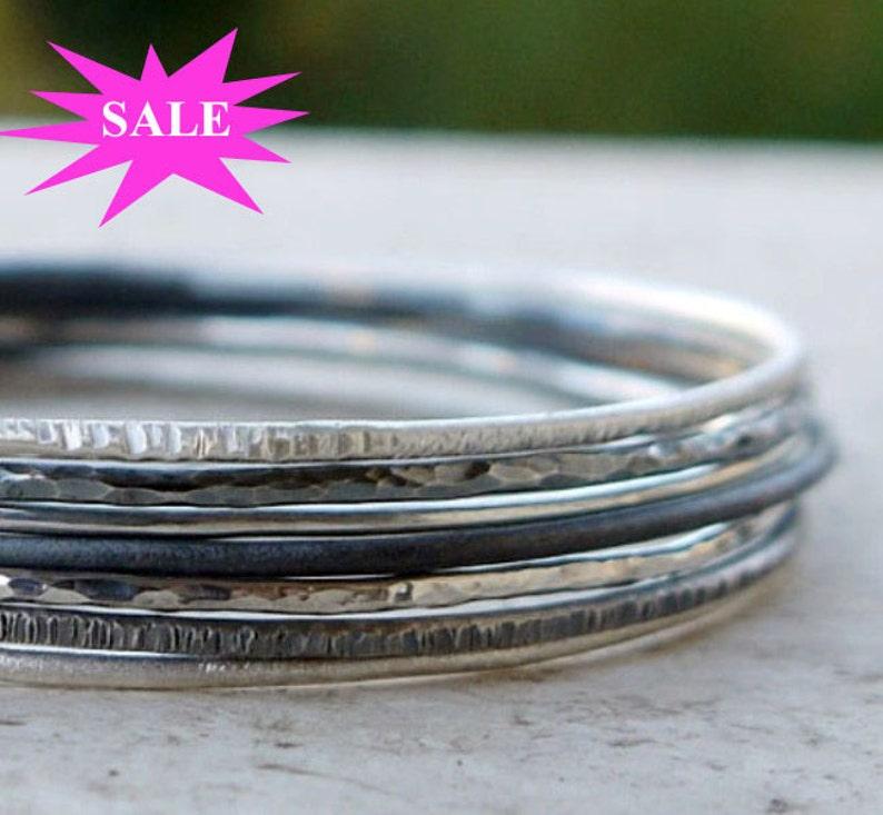 Silver bangles set of 7 skinny stacking bangles hammered image 0