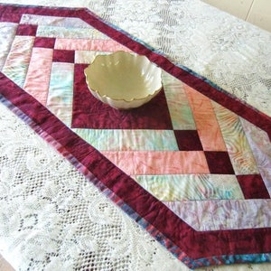 quilted square table mat with tropical flower fabric /& batik binding Hawaiian table d\u00e9cor for tropical home Hawaiian Plumeria Table Topper
