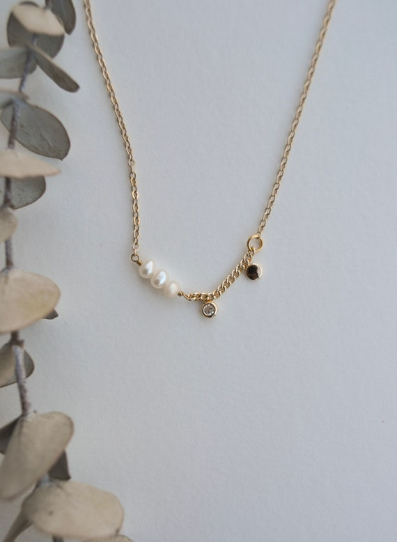 Cybele - dainty gold plated necklace with crystal center and side pearl accent.