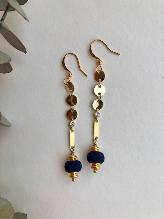Evelyn - gold plated long dangle earrings accented with navy blue bead