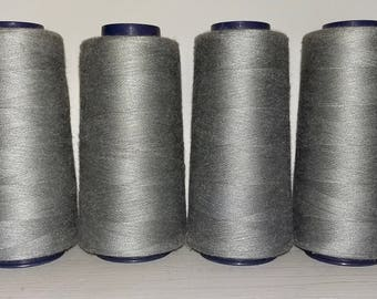 Set of 4 large spools of thread color grey