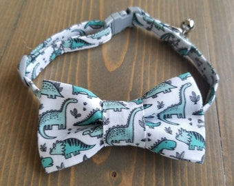 5d849a04ad1f Dinosaur Print Lightweight Fabric Cat Collar with Matching Bow Tie,  Breakaway Clasp, Safety Buckle, Optional Bell, Dinosaurs, Green, Grey