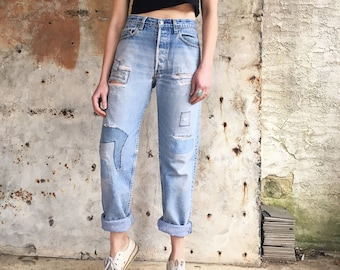 1970s Light Wash Levis Distressed Patched Red Tab Slim Cut Jeans 30