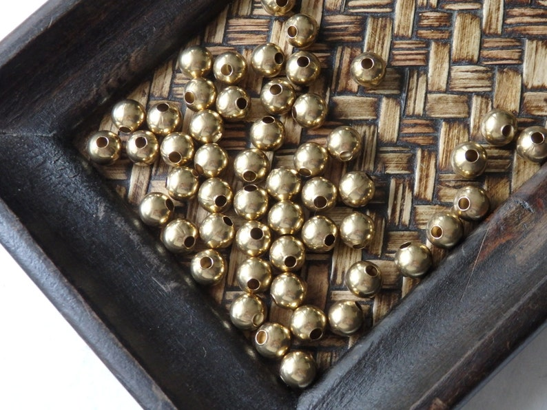 8mm Indian brass beads gold-tone brass beads 50g. seamless round brass beads with 2mm hole 8mm Brass beads from India approx. 90 pcs.