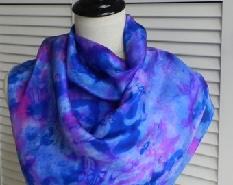 Square silk scarf hand dyed in shades of blue and magenta pink in an abstract design, ready to ship