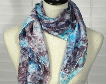 Hand dyed square silk scarf in an abstract design of turquoise blue and plum purple