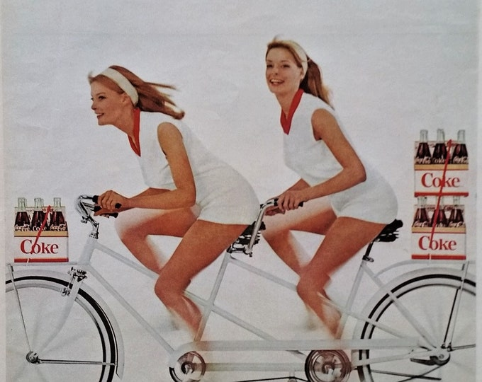 """Twins. Redheads. Girls. Tandem Bike.  Booyah!   Coke Coca-Cola Ad ad; gals are pedalling wild,  """"For Extra Fun...take more than one.""""  13x10"""