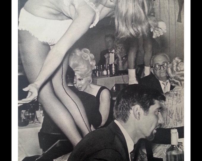Joe Namath makes the girls bend over backwards!  BW Photobomb of Broadway Joe at bar in NY.  NY Jets 1960s