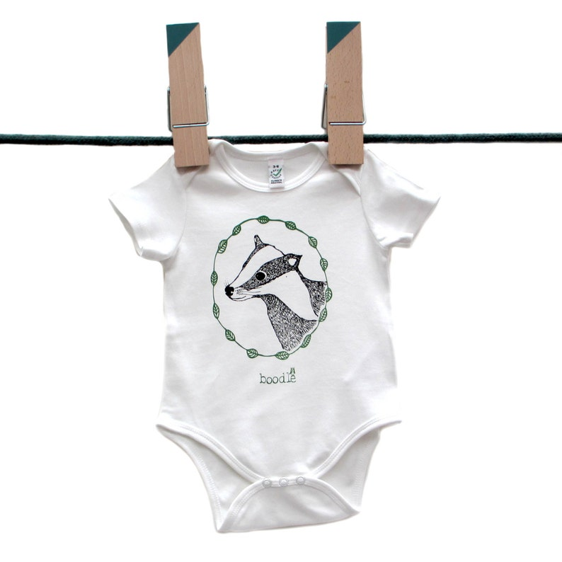 Featuring /'Betty the Badger/' in a circle of leaves. hand screen printed with eco-friendly inks Organic Badger Baby grow