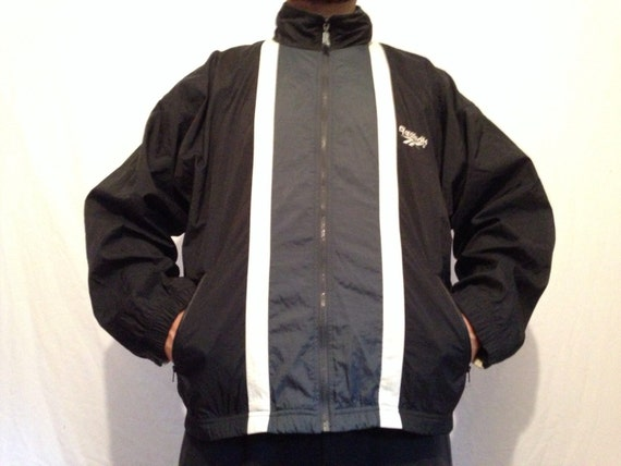 16442a989a6 90 s Reebok Windbreaker Track Jacket Roll Up Hoodie Medium