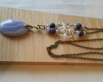 Blue crazy lace agate, clear quartz crystal and blue coral necklace.
