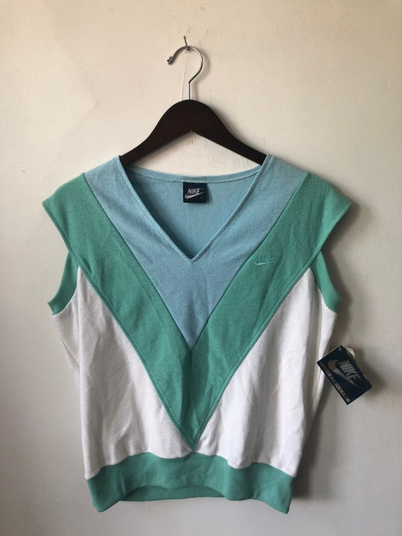 vintage nike blue tag v-neck shirt women's size large image 0