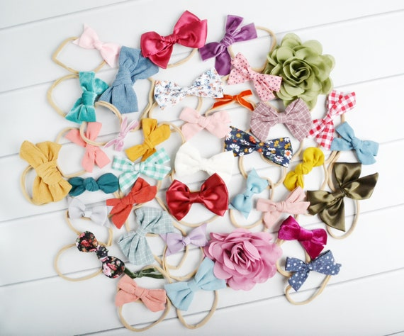 Mix of Headbands.Different styles Toddler. 5 wide nylon One size fits all Baby Girl Headbands 1 skinny nylon BOWS Grab bag of 6