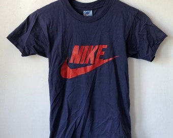 91e8a87dd97f2 vintage nike orange tag swoosh t-shirt mens size small 80s made in USA